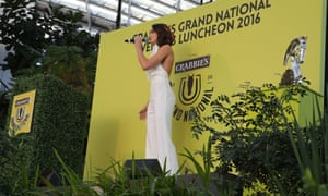 Mezzo-soprano Laura Wright performs the song Skyfall at the Grand Natonal weights lunch at the Sky Garden in London.