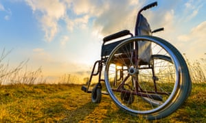 Empty wheelchair at sunset