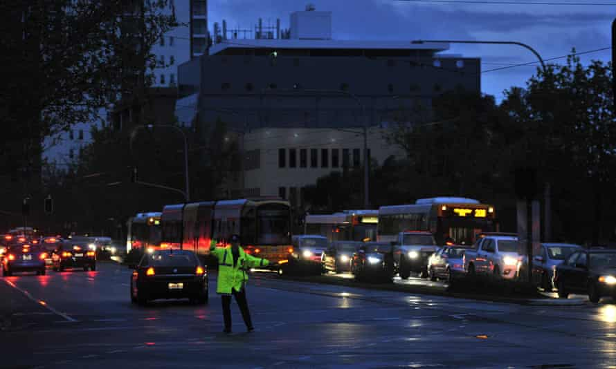 Police direct traffic around Adelaide's CBD after a statewide blackout following a major storm last year. The episode led to the government blaming the network's problems on the state's high uptake of wind power.
