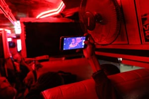 A passenger takes a selfie inside a matatu as he waits for it to fill