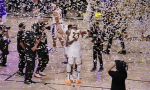 Lakers players celebrate after securing the title with victory in Game 6
