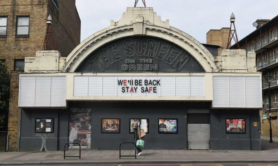 The closed Screen on the Green cinema in Islington, north London, with someone walking by