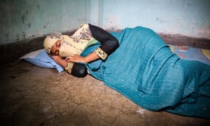 Fatima in the room where she sleeps with two other garment workers.