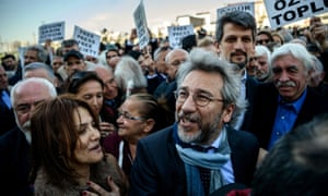 Can Dündar, editor-in-chief of Cumhuriyet daily newspaper, arrives at the Istanbul courthouse for his trial on 1 April 2016