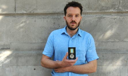 Neal Russell with his Ebola medal