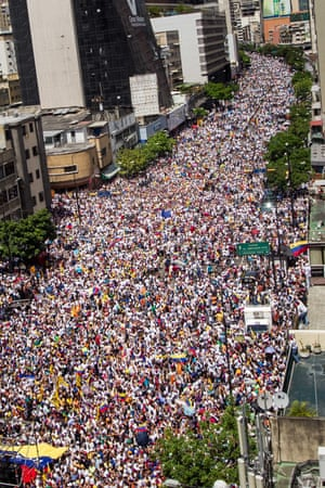 Thousands of people participate in a referendum rally in Caracas last September.