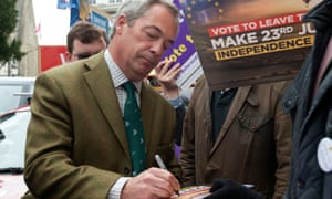 Nigel Farage signs vote leave boards during his party's referendum Brexit battlebus tour in Kingston, London, today.