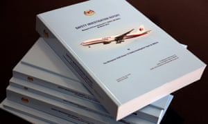 Stack of MH370 safety investigation report booklets is pictured at a closed door meeting with family members in Putrajaya