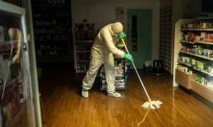 Cleaning teams at work after County Oak medical centre in Brighton was closed due to a staff member contracting the virus.