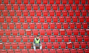Bayern Munich substitute Lukas Mai in the stands wearing a protective face mask during the German Bundesliga soccer match on 17 May 2020, as play resumes behind closed doors.