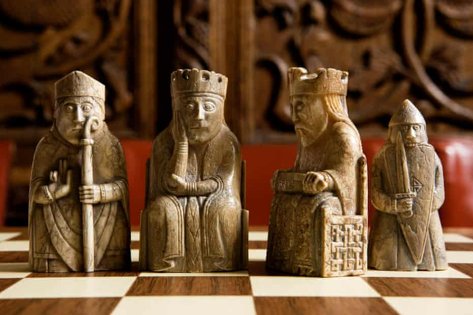 The Lewis ChessmenA bishop; a queen; a king and a berserker rook or castle made from the walrus ivory and whales teeth - part of the medieval Lewis Chess Sets.