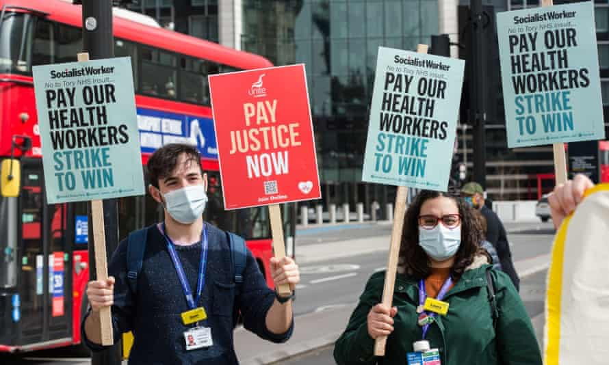 NHS staff protest over pay outside St Thomas' hospital in London in April.