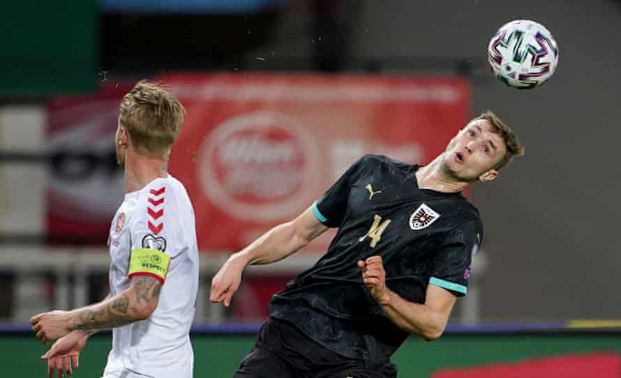 Austria's forward Sasa Kalajdzic heads the ball.