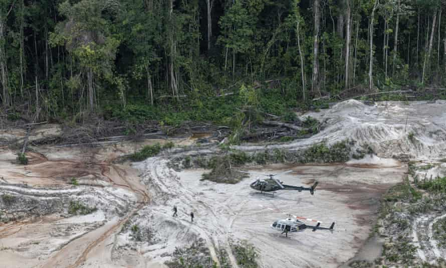 Inspectors walk through an area affected by illegal mining in Pará state in Brazil's Amazon basin