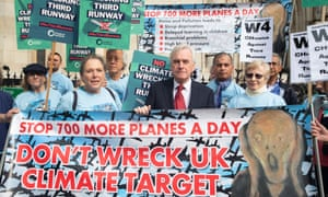 The shadow chancellor, John McDonnell, with protesters outside the high court