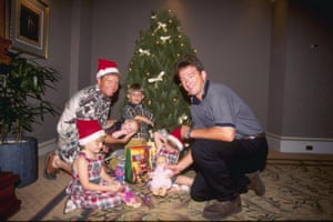 Australia's Ian Healy, left, and team-mate Mark Waugh enjoy Christmas with their children ahead of the start of the third test between Australia and West Indies at the MCG in 1996
