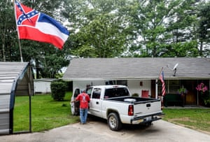 Joe Barnes gets into the truck at his home in Seminary, Mississippi.