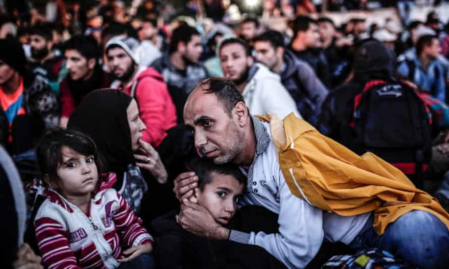 Refugees wait in Istanbul for buses to the Turkish-Greek border