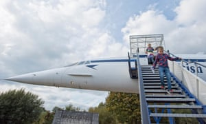 Kids come down the gangway on the Concorde tour at Brooklands Museum, Weybridge, Surrey