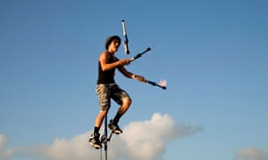 Street performer on a unicycle juggling