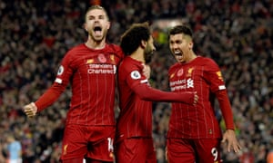 Mohamed Salah celebrates scoring Liverpool's second goal with Jordan Henderson and Roberto Firmino.