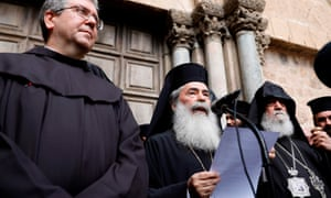 Greek Orthodox leader Theophilos III delivers a statement to the press outside the closed doors of the Church of the Holy Sepulchre in Jerusalem's Old City