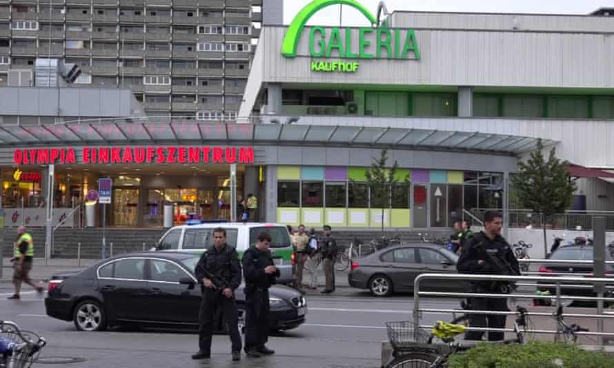 Police guard the Olympic Park shopping centre after the attack.