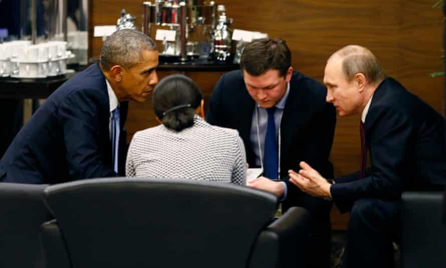 Barack Obama talks to Vladimir Putin during a break of the G20 summit working session in Antalya, Turkey, on Sunday.