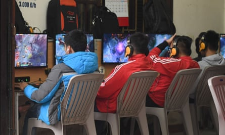 High school students play online games at a shop in Hanoi.