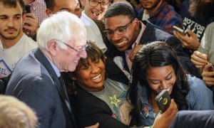 Bernie Sanders poses for selfies with supporters during his campaign event at Morehouse College, a historically black college in Atlanta.