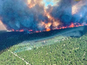 A wildfire burns at Sparks Lake in Thompson-Nicola, British Columbia