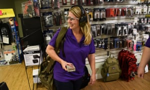 Jenny Hildebrand carries a bag that holds two guns and ammunition to the indoor range.