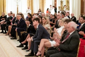 President Donald J. Trump listens as songs are sung at a remembrance candle lighting during a reception to honor Gold Star Families Sunday, Sept. 27, 2020, in the East Room of the White House.