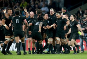 Dan Carter celebrates with his teammates at the final whistle.