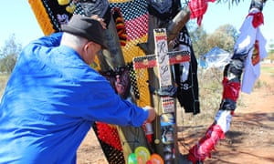 Albert Doughty places a toy motorbike at the memorial for his grandson, Elijah Doughty.