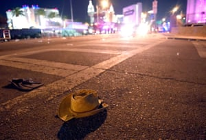 A cowboy hat lays in the street