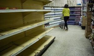 Empty supermarket shelves in Caracas.