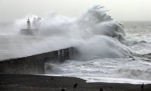 Waves hit a harbour wall in Newhaven, East Sussex
