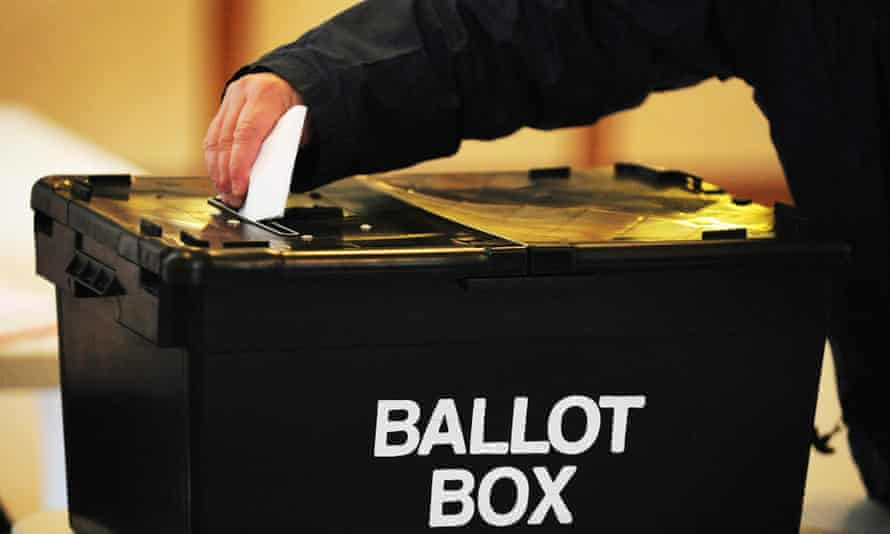 Man casts vote in ballot box