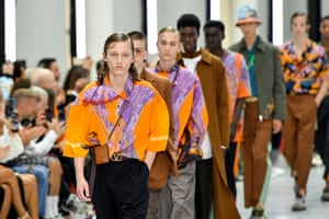 Valentino: Pierpaolo Piccioli took us on an imaginary trip to utopias for spring/summer 2020. Eye-catching dreamlike landscape prints by the artist Roger Dean, taken from artwork he created for prog rock album covers in the 1970s, were redeployed on short shirt shirts and an ankle-length kaftan-cum-windcheater and embroidered onto T-shirts and military jackets. The trouser shape throughout was tapered and loose in the leg with a wide contrast stripe down the leg. Accessories had a picked-up-on-holiday feel, with coral-inspired necklaces and sun hats.