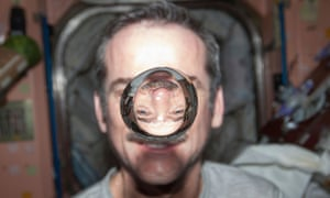 Canadian Space Agency astronaut Chris Hadfield, Expedition 34 flight engineer, watches a water bubble float freely between him and the camera, showing his image refracted, in the Unity node of the International Space Station, in this handout photo courtesy of NASA, taken January 21, 2013. Hadfield becomes the first Canadian commander of the International Space Station, March 13, 2013. REUTERS/NASA/Handout (OUTER SPACE - Tags: SCIENCE TECHNOLOGY) FOR EDITORIAL USE ONLY. NOT FOR SALE FOR MARKETING OR ADVERTISING CAMPAIGNS. THIS IMAGE HAS BEEN SUPPLIED BY A THIRD PARTY. IT IS DISTRIBUTED, EXACTLY AS RECEIVED BY REUTERS, AS A SERVICE TO CLIENTS