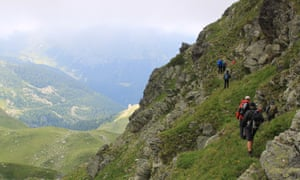Rocky road: trekking in the Accursed Mountains along a tough steep trail.