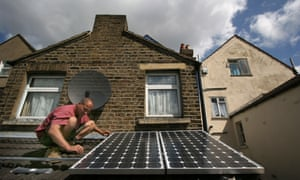 Solar panels being installed on the roof of a house in London.