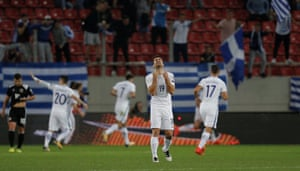 Greece's Sokratis Papastathopoulos celebrates a goal in Gibraltar during the qualifying campaign