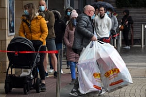Shoppers queue to enter a Smyths Toys shop in Glasgow, UK, ahead of the introduction of further coronavirus restrictions in Scotland