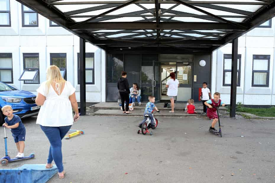 Children play in the car park at the entrance to Shield House.