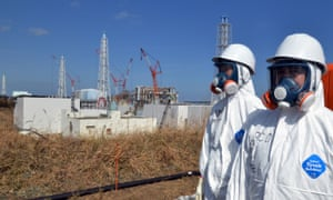 Tokyo Electric Power workers and the damaged plant