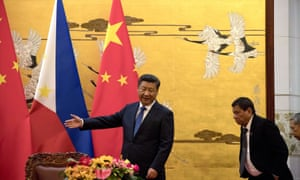 The Philippine president, Rodrigo Duterte, is shown the way by his Chinese counterpart, Xi Jinping, before a signing ceremony in Beijing, China.