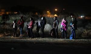 Queue of migrants in dark