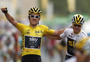 Thomas celebrates with Froome as he crosses the finish line.